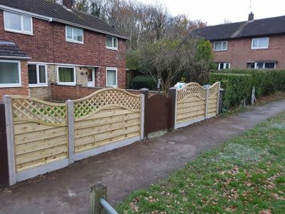curved fence nested in a concrete gravel board kettering