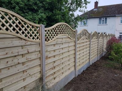 Residential fencing with curves styling ontop installed in Corby