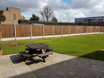 long commercial fencing installed six foot feathered edge fence with concrete gravel boards