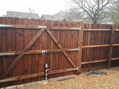 dark wood timber feathered edge two door french style gate with bottom locking