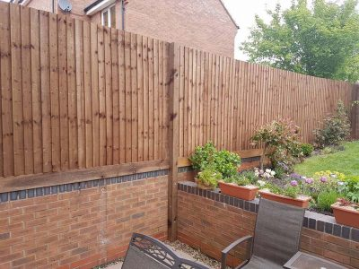 feathered edge fence above a brick wall installation