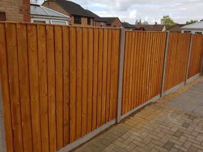 six foot tall feathered edge fencing installed in Corby