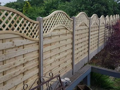 Residential fencing with curved top installed in Corby