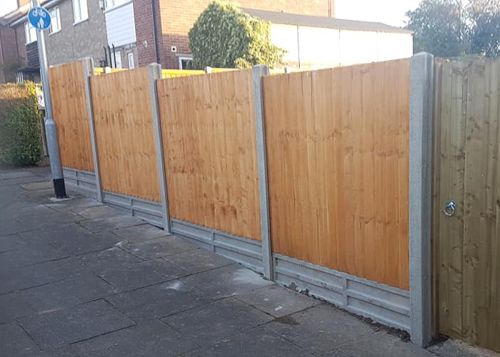 replacement of a three foot wall and 3ft fence with a 6 foot fence with concrete gravel boards