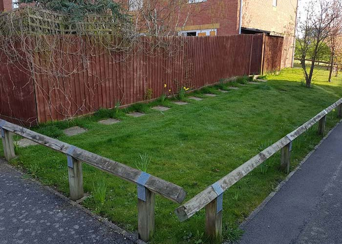 a large garden space with low separator fence replacement to extent garden