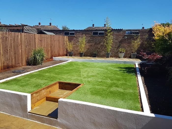 raised garden installation with new grass install an fencing around the outside in corby