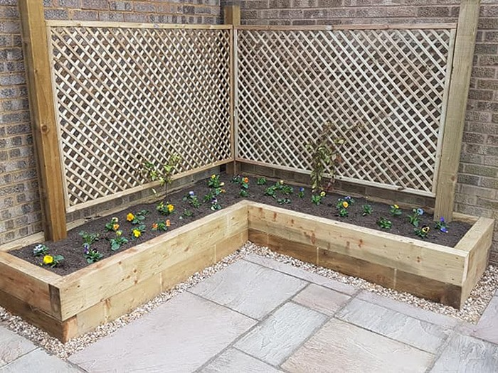 garden flower patch installation in corby with trelis for vine growth