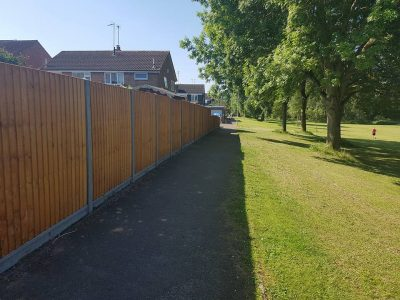 six foot tall fence with feathered edge pannels and concrete gravel boards