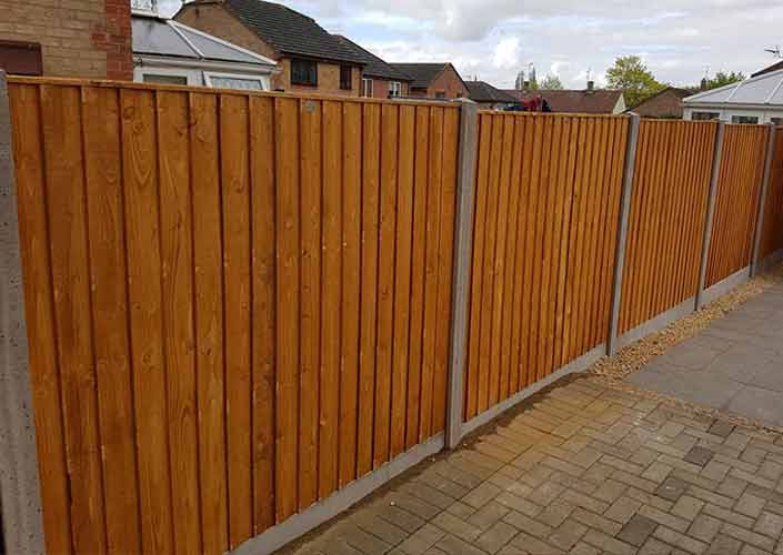six foot tall feathered edge fencing installed by Corby Fencing