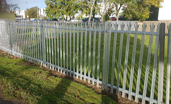 wire mesh fence installed commercial property with prongs aligned on the top
